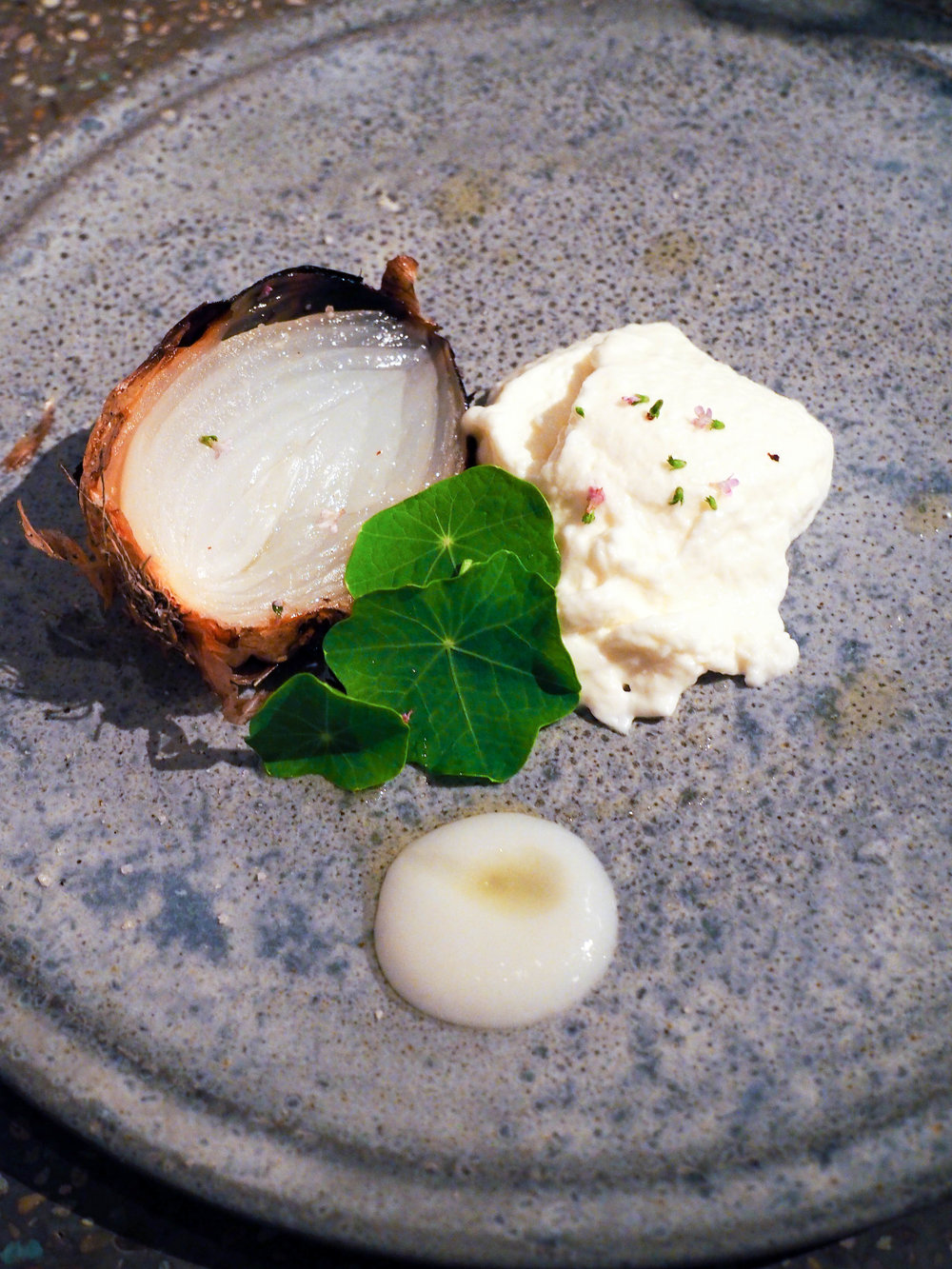 The creamiest oven charred onion served with a cream mousse