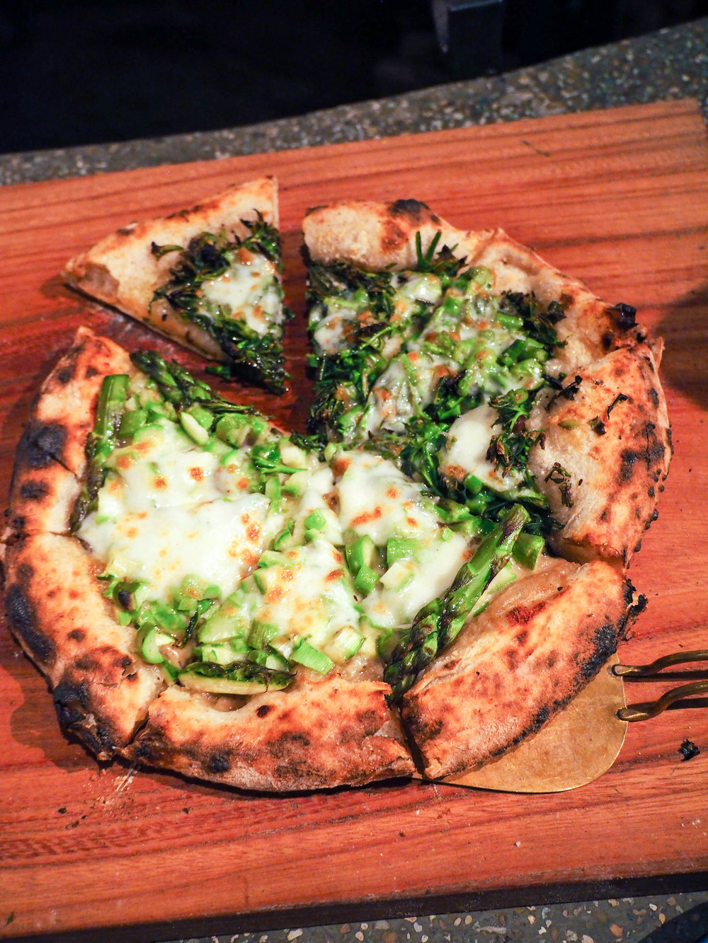 The BEST pizza I've ever eaten! He ferments his own starter to make the dough from locally grown wheat. Half was topped with anchovy paste, asparagus and mozzarella and the other half was topped with taranome, a bitter Asian green (I think it's also called angelica).