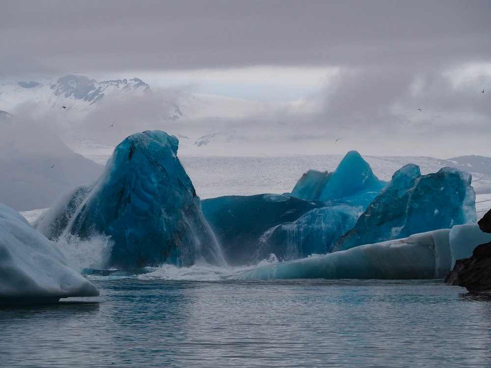 All of a sudden we heard a huge crash and it was this iceberg breaking in half and flipping over!