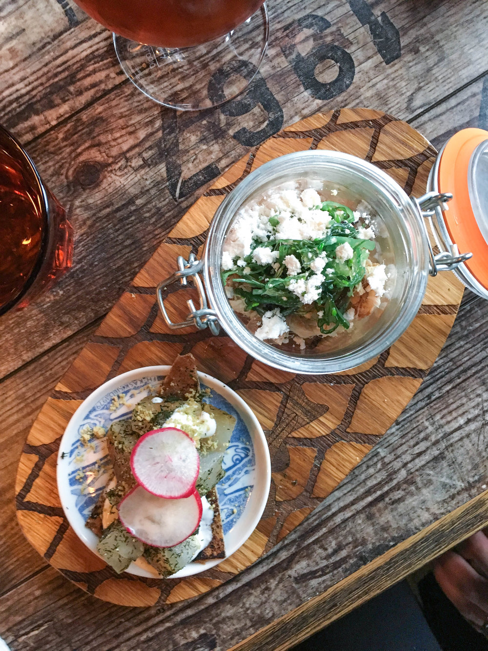 Local smoked fish appetizer: dill marinated trout on Icelandic flatbread with horseradish cream and smoked trout in a jar with sesame snow and wakame salad