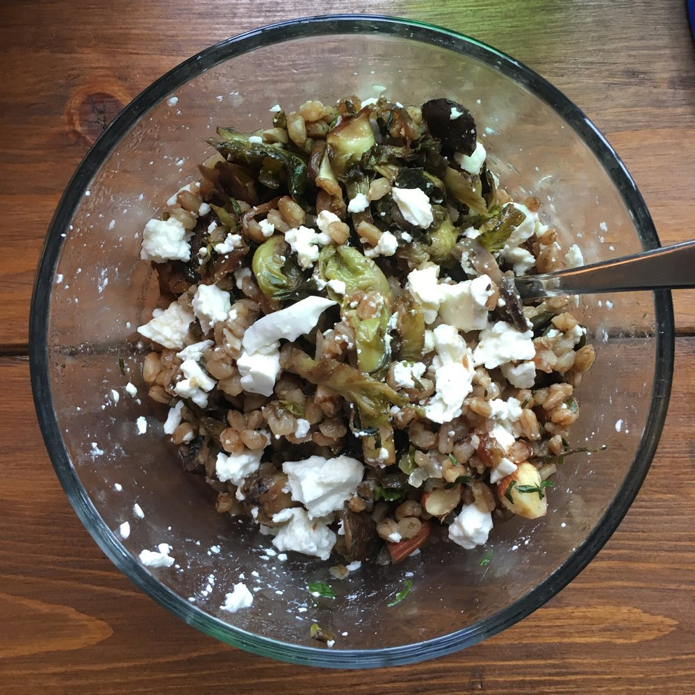 Threw some leftover brussels sprouts, farro, almonds and feta together in a bowl and gave it a toss.