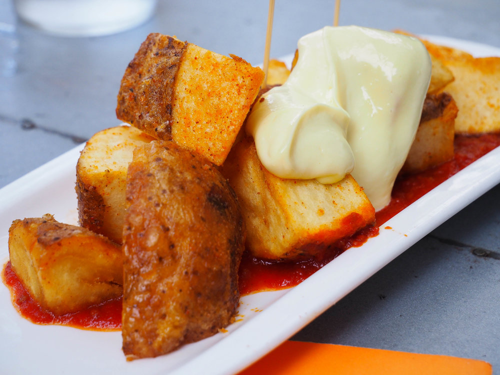 Patatas bravas are one of m favorite tapas dishes! Crispy roasted potatoes in a spicy tomato sauce with aioli.
