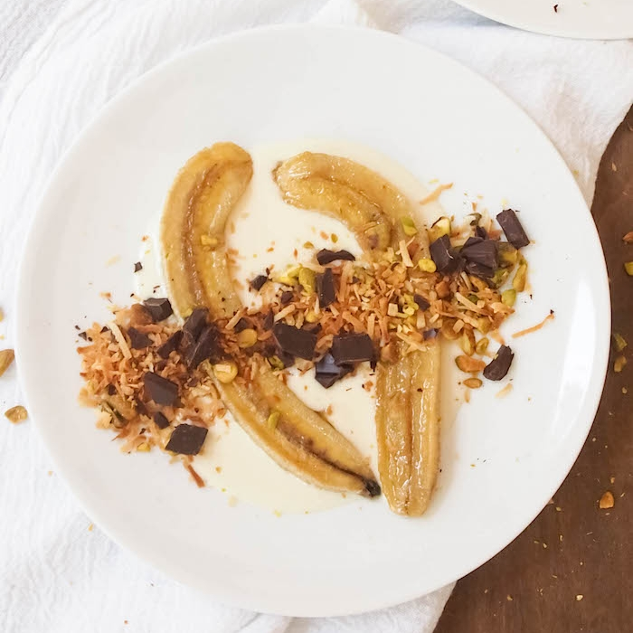 Roasted Bananas with Salted Coconut Cream, Dark Chocolate and Pistachios
