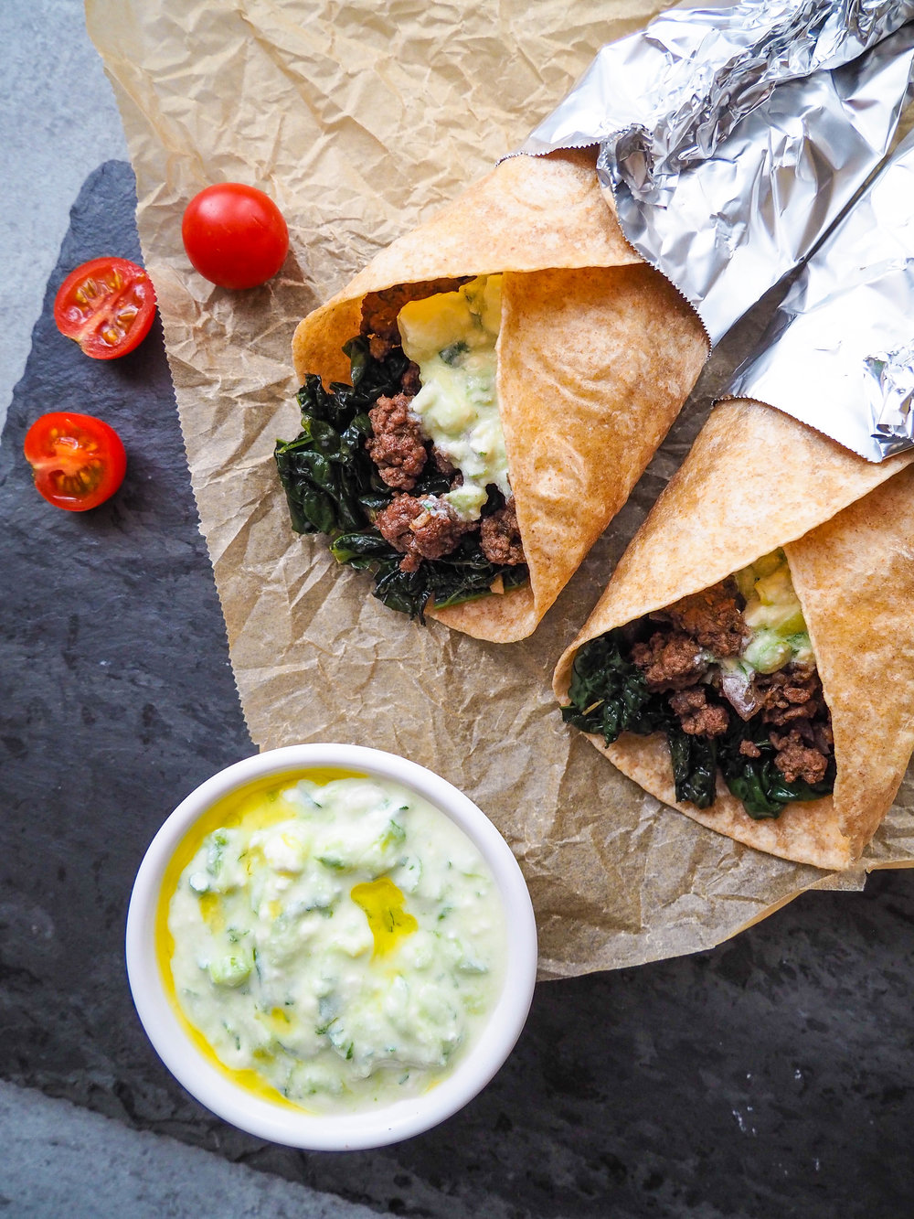 The creamy feta sauce that goes with these Greek Tacos with Kale makes the dish! Whole family will love this recipe! #recipe #taco #kale #beef