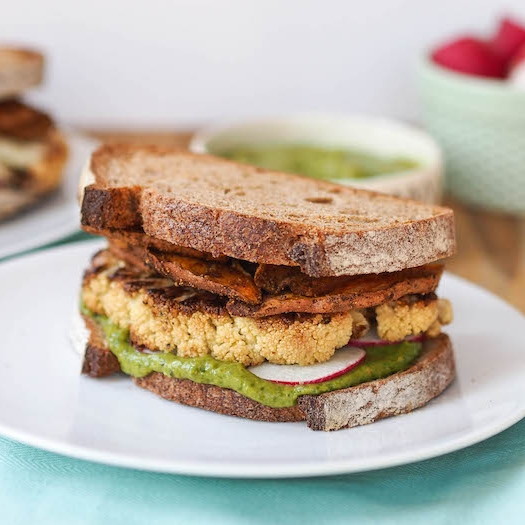 Roasted Cauliflower Sandwich with Spicy Sweet Potato Chips and Avocado Cilantro Sauce
