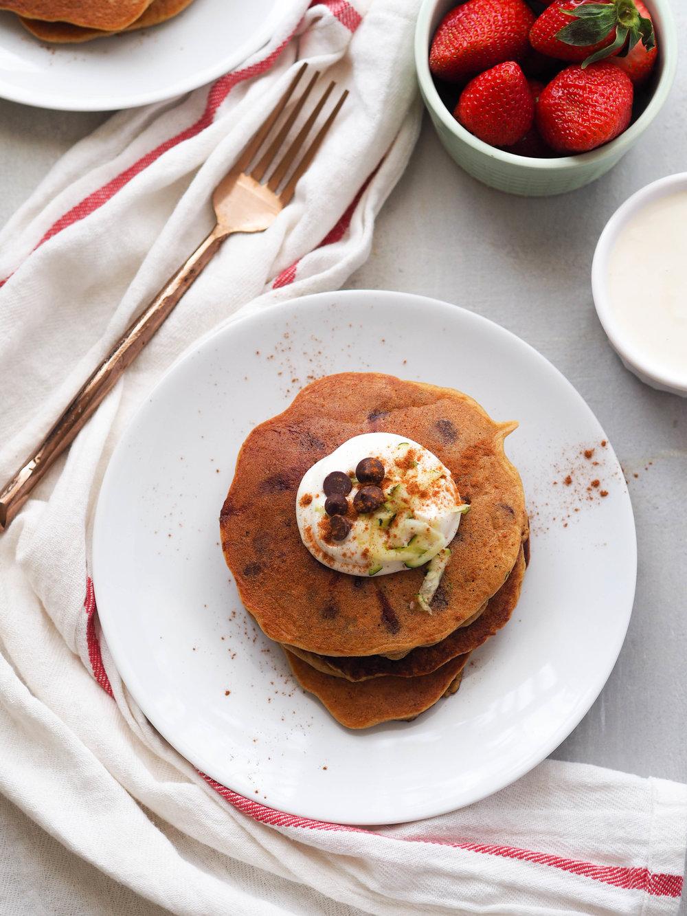 Zucchini bread in pancake form, plus dark chocolate chips! Make these almond flour zucchini bread chocolate chip pancakes, topped with a maple Greek yogurt topping! #breakfast #pancake #chocolate #glutenfree #grainfree #brunch #healthyrecipe