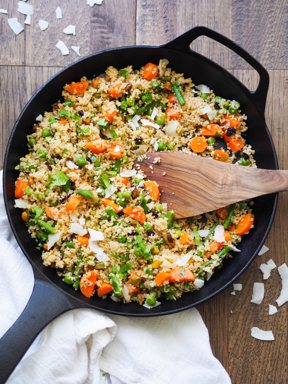 Make this spring vegetable coconut couscous with spicy harissa chicken! Mix in any vegetables you like in this easily adaptable dish! Takes less than 30 minutes! #harissa #dinnerrecipe #easyrecipe #30minutemeal #couscous #wholegrain #asparagus #spring