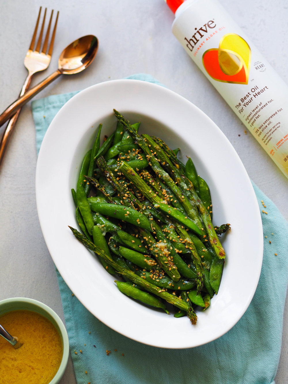 Grilled Spring Vegetables with Miso-Lime Dressing! Throw asparagus and snap peas on the grill and drizzle with a probiotic rich miso-lime dressing for an easy seasonal side! #vegan #vegetarian #sidedish #asparagus #grilling #probiotic
