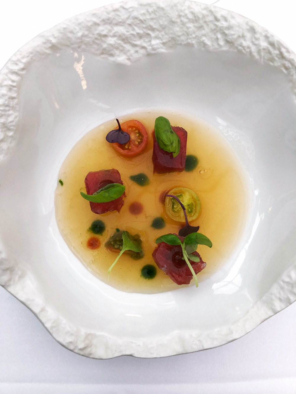 Chilled smoked tomato and basil consomme with marinated tuna, plankton and rosehip. This was one of my favorites.