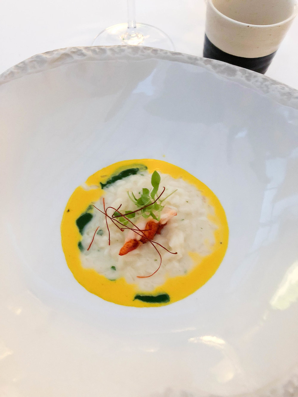 Lobster rice with saffron sauce. It was served with a cup of hot bouillabaisse broth on the side.