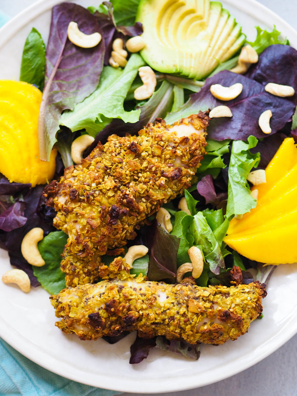 The perfect chicken salad for summer, packed with tons of fresh flavor! Make this coconut curry crusted chicken salad with mango and a homemade honey mustard dressing! #salad #summer #chicken #healthyrecipe