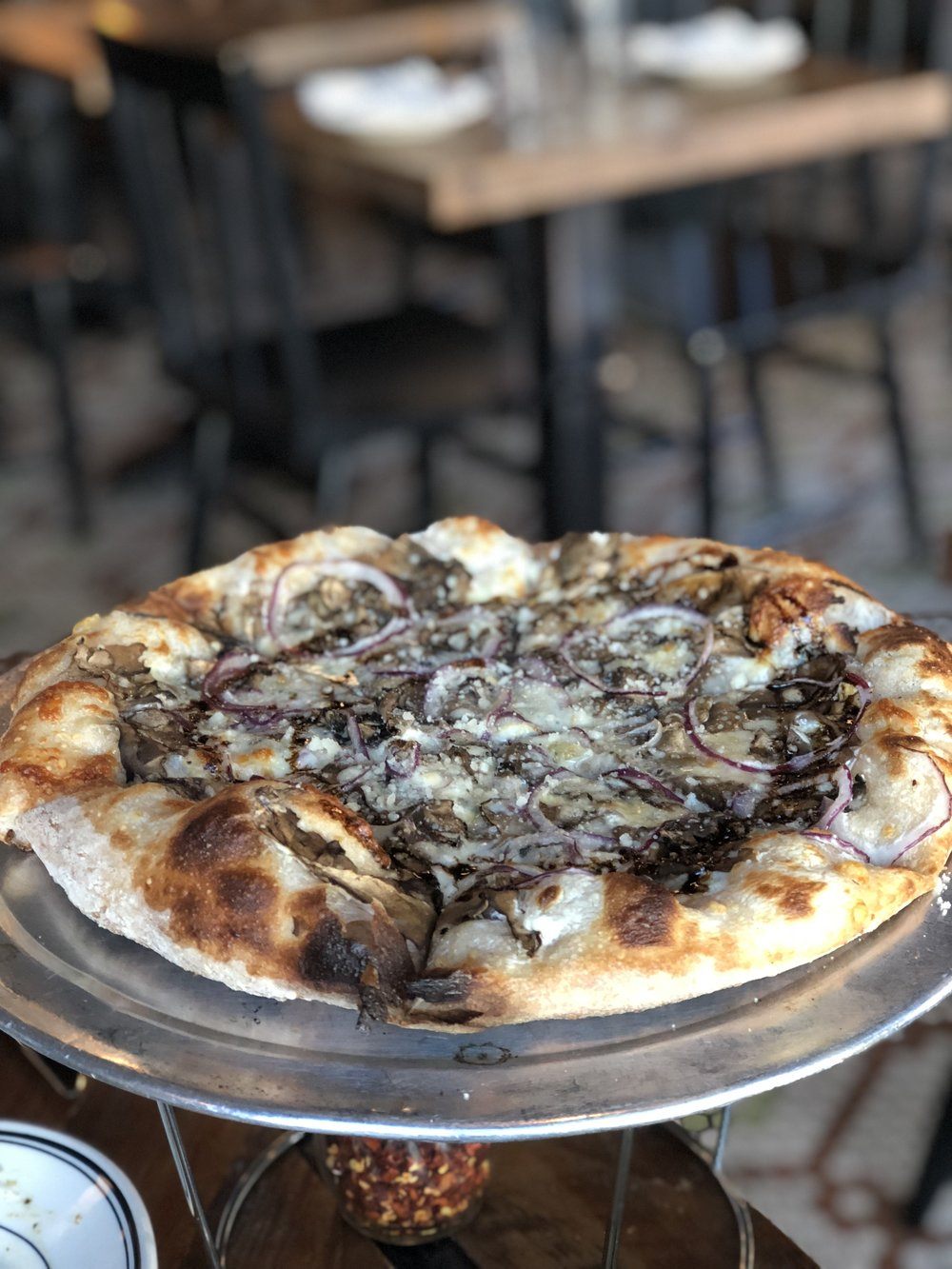 Pizza with roasted mushrooms, smoked mozzarella, caramelized onion, gorgonzola and balsamic