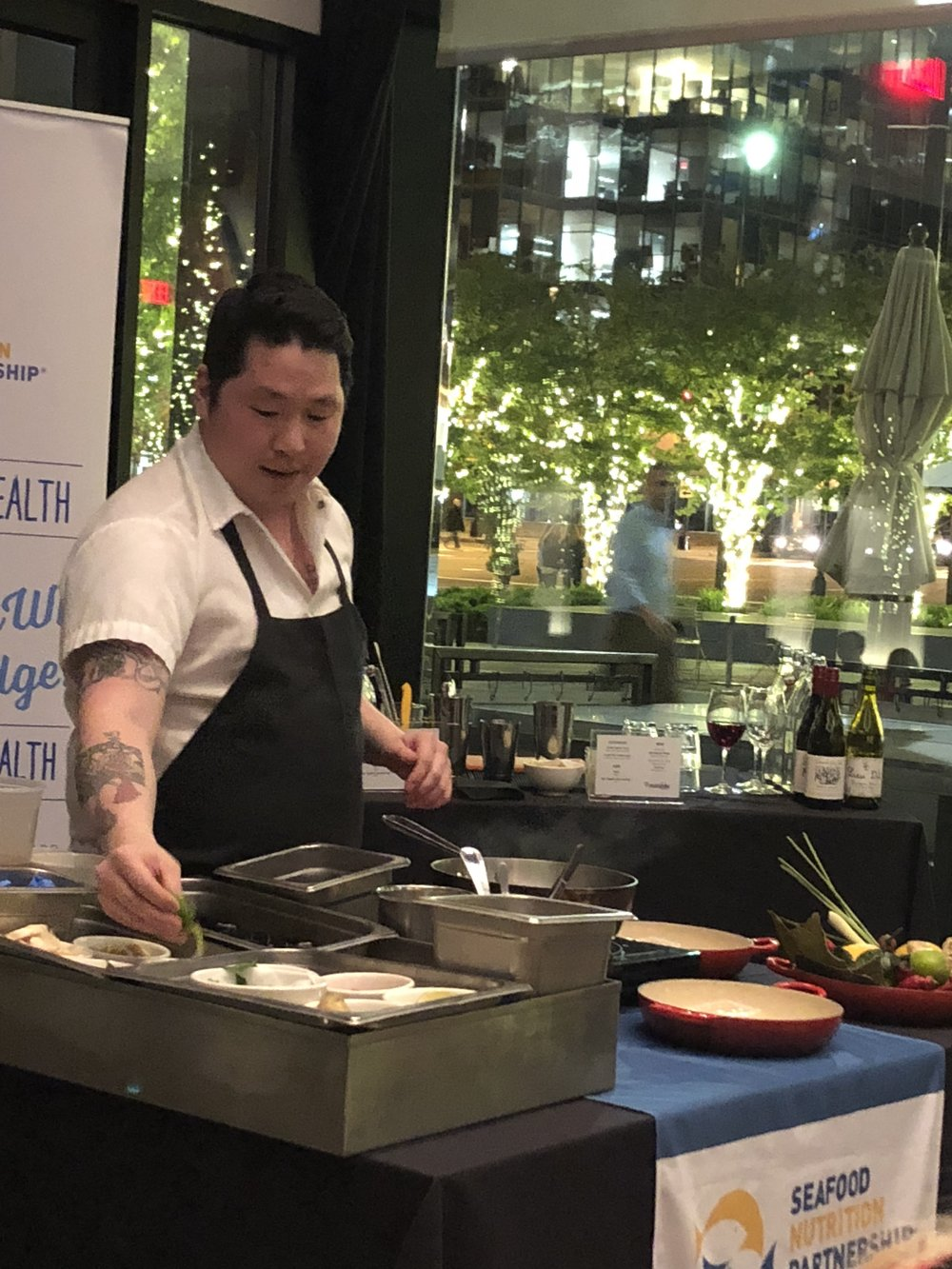 Chef doing a demo of mussels steamed in dashi and lemongrass