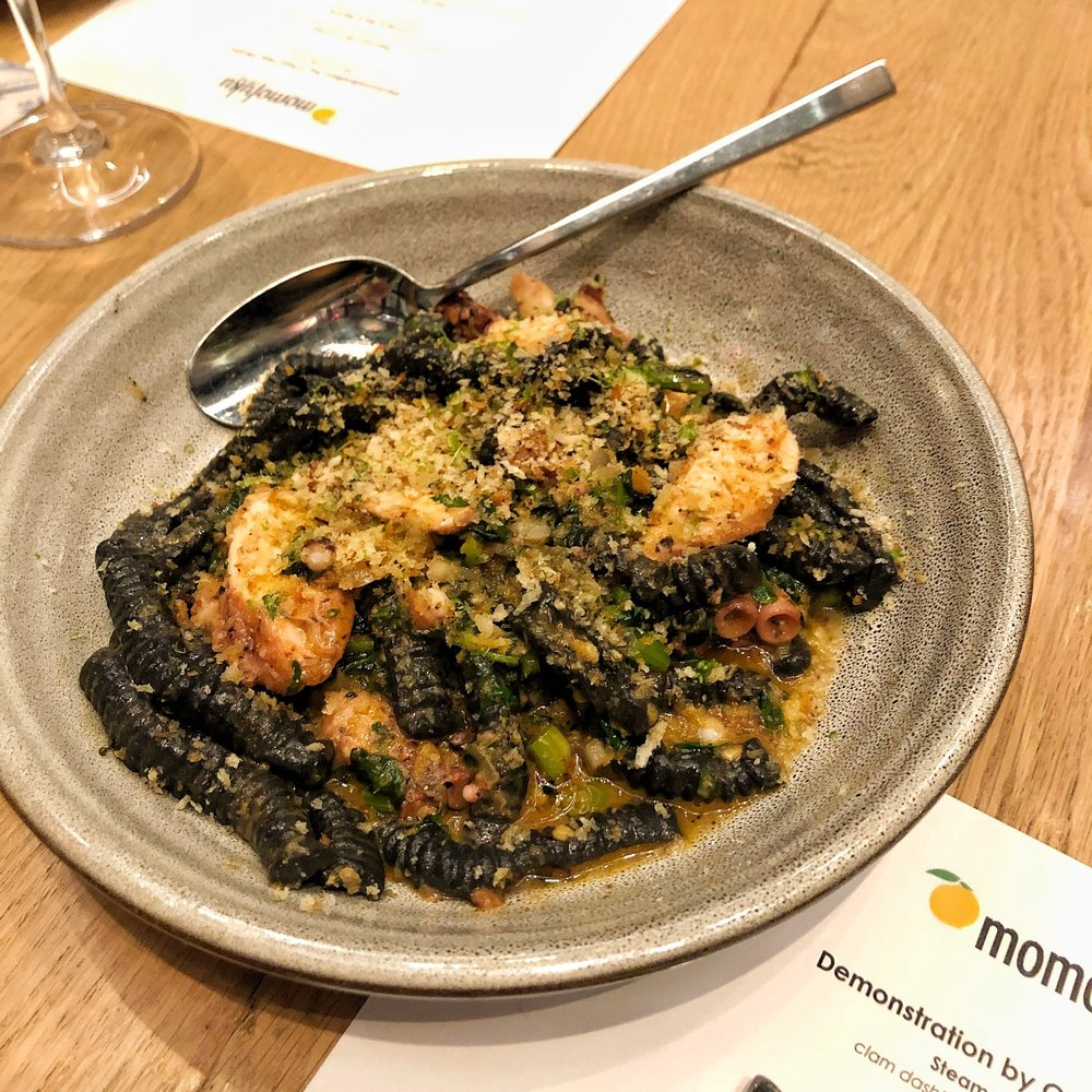 Squid ink cavatelli with pickled mussels, braised octopus, 'nduja butter and Thai basil