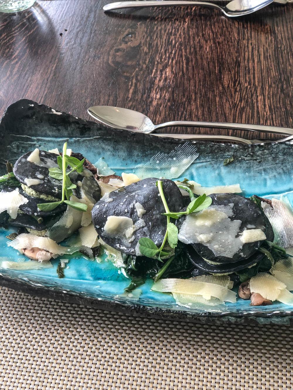 Spinach and ricotta squid ink ravioli