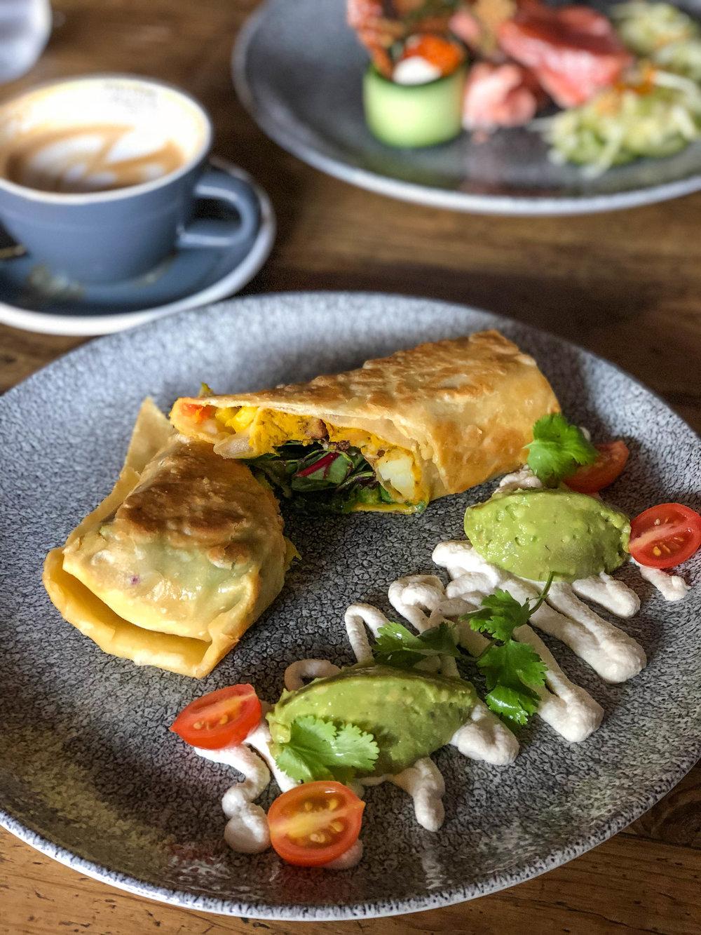 Vegan breakfast burrito with sweet potatoes, mango salsa, and black beans