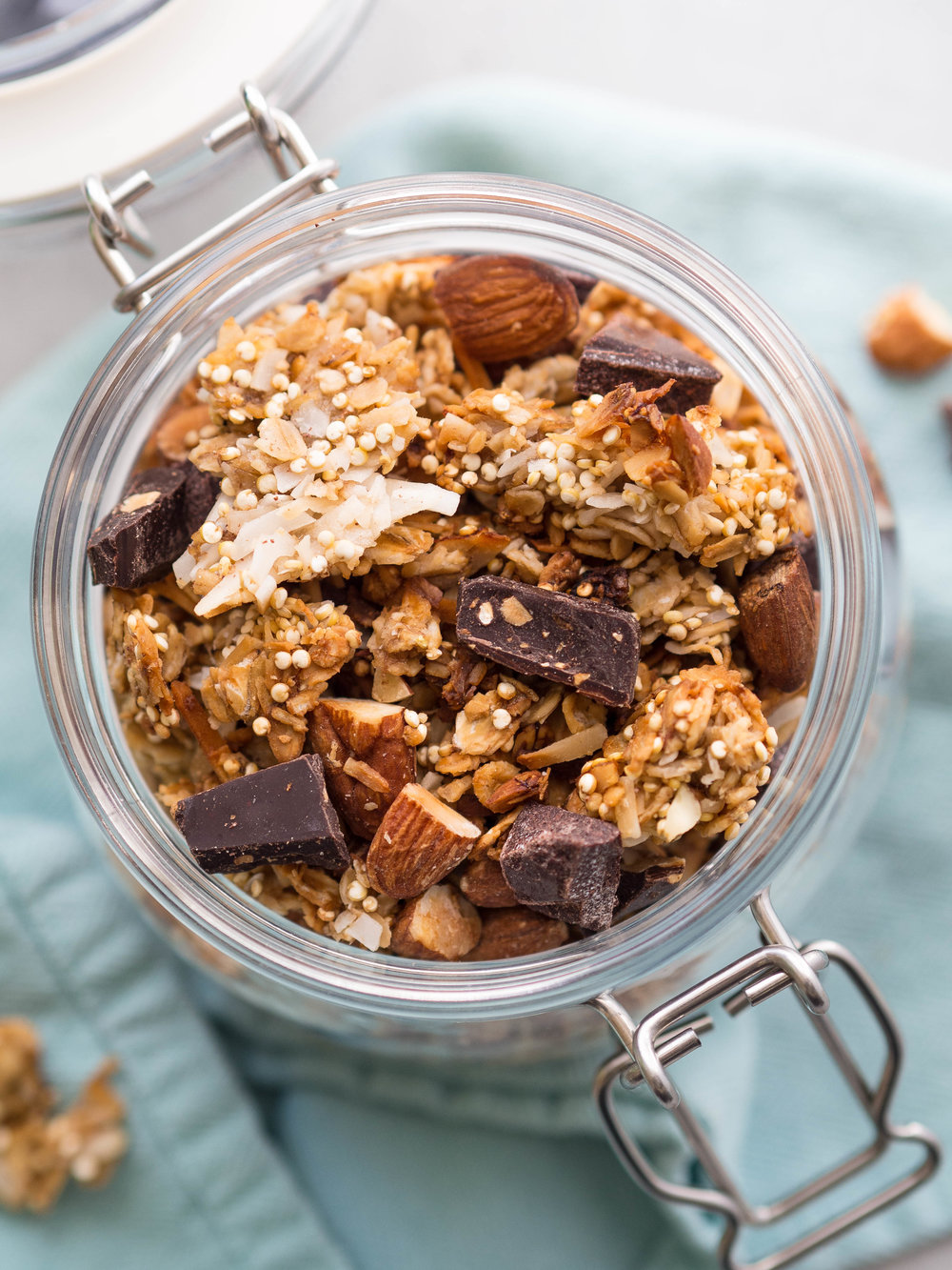 Dark Chocolate, Coconut and Almond Granola! Perfect with creamy yogurt for breakfast! Made lower in sugar by using bananas and maple syrup to sweeten. #granola #darkchocolate #snack #healthysnack #vegan