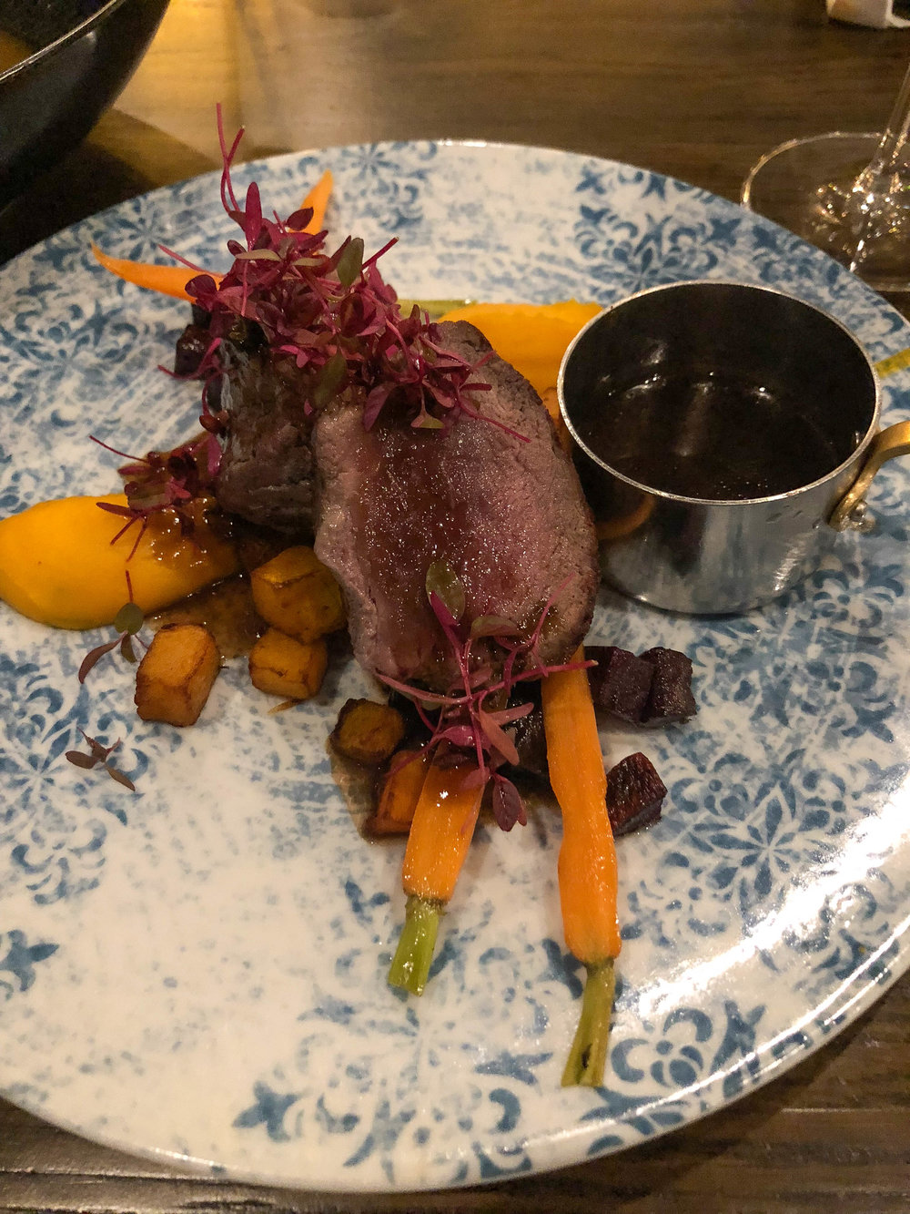 South African-style grilled ostrich with pinotage jus and butternut mash
