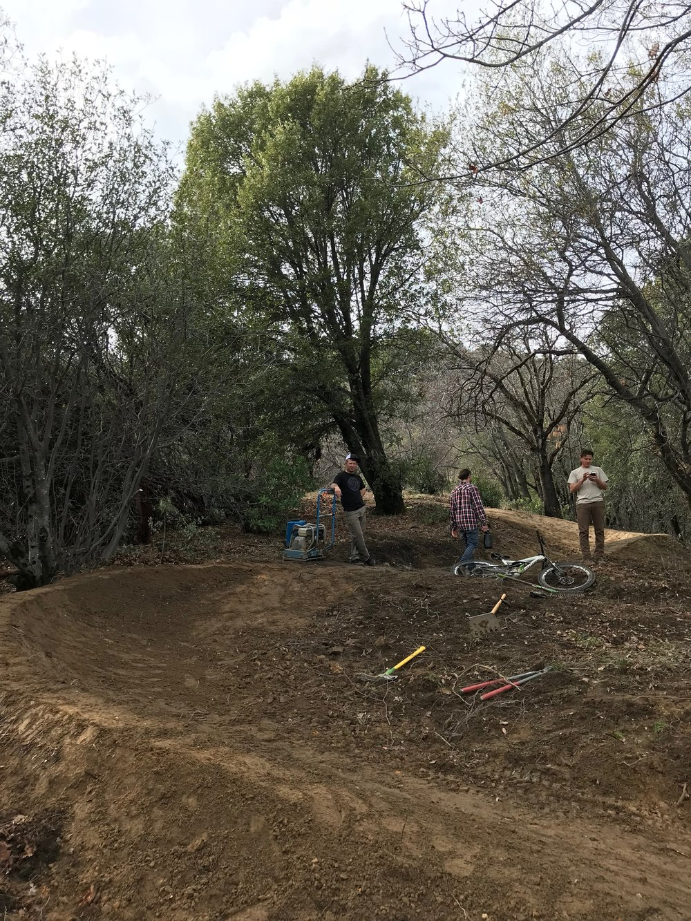 RTA trail crew taking a break before applying the finishing touches (uphill)