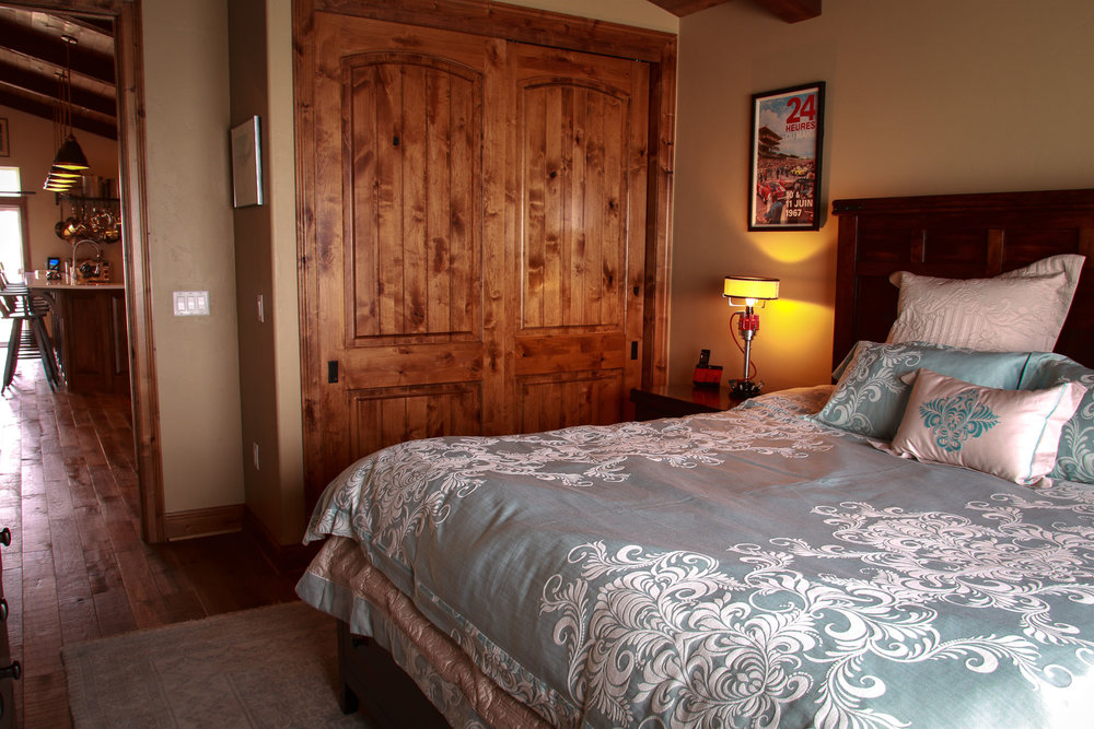 The king guest room offers plush linens and additional closet space for extended stays.