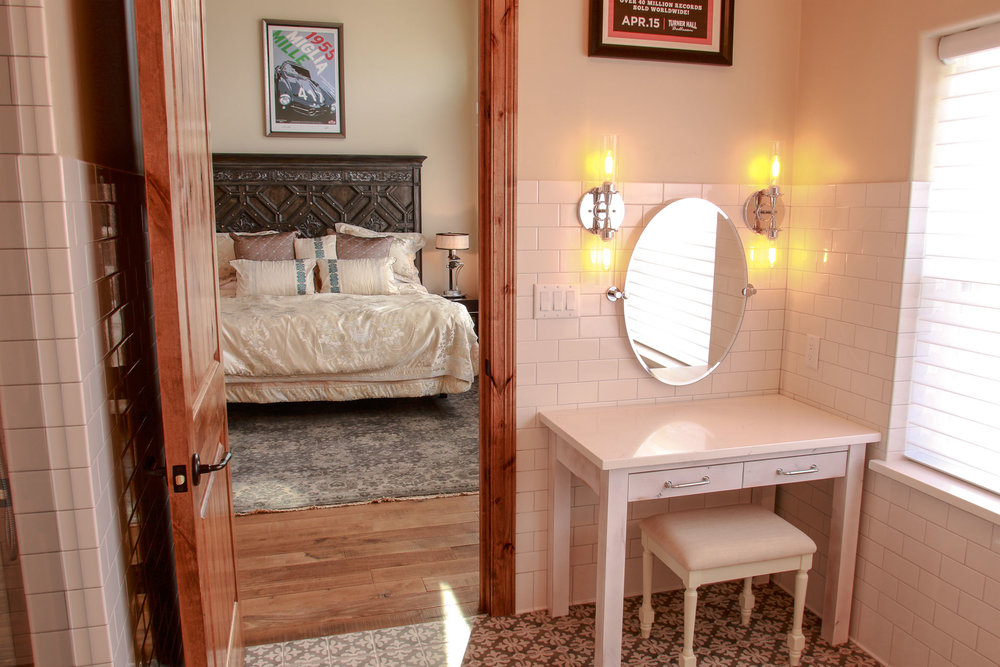You'll feel spoiled in the spa-like master bath with custom-made vanity space and precious materials from floor to ceiling.