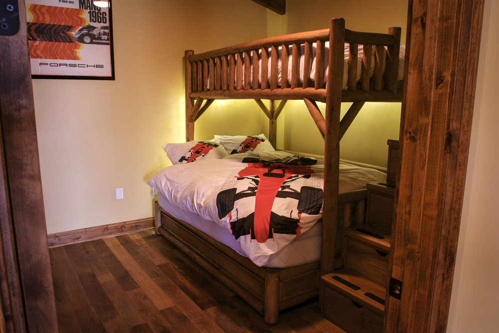 An additional guest room offers bunk-bed style sleeping with an added trundle bed for that extra guest!
