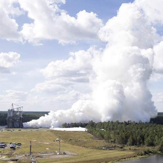 The exhaust of the RS-25 meeting the clouds. Photo Credit: NASA, Stennis Space Center