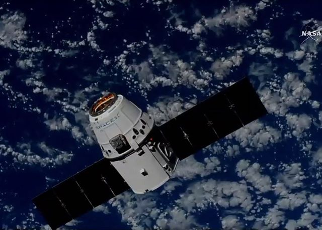 The @SpaceX Dragon was successfully captured by astronauts aboard the @iss earlier today. The Dragon was packed full of almost three tons of cargo, most of which will be used for scientific experiments. Key experiments and equipment include some updated gardening supplies to grow lettuce and wasabi mustard in space, an experiment based around testing algae as a potential long duration spaceflight food, and CIMON (see our earlier post to learn more about this floating AI). The astronauts will also be conducting tests around the effectiveness of cancer treatment drugs and installing a new piece of hardware (ECOSTRESS) to the station that will track how plants on Earth respond to lack of water and heat stress.  Astronauts also received a taste of home in the form of blueberries from Texas, some extra strong coffee (by @deathwishcoffee), and a few ice cream bars - an especially rare treat in space. - What experiments are you most excited for? Let me know in the comments! - Photo Credit: @nasatv - #Space #science #stem #astronomy #nasa #outerspace #mars #planets #solarsystem #rocket #astronaut #earth #spacetravel #spacex #dragon #iss #experiment