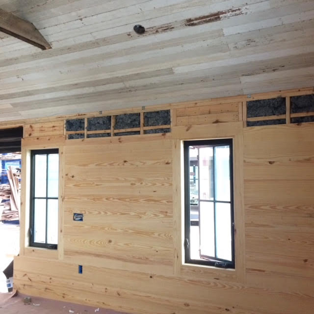 Bead board from old Texas porches and a Texas Panhandle church go up on the ceilings. The living room begins to take shape.