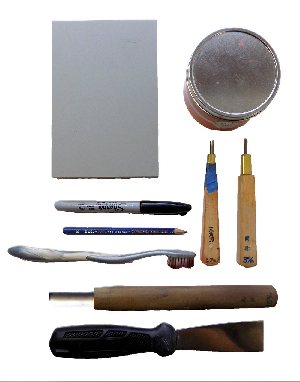 My go-to tools  for linocut preperation: lino block, ink, pencil and sharpie, toothbrush for cleaning away lino chips, small cutting tools, and a large U-gouge tool for clearing large spaces  -