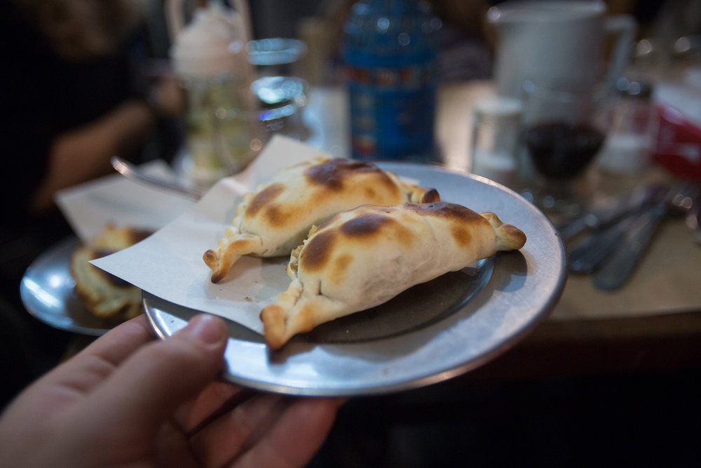 A pair of empanadas at Pulperia Ña Serapia.