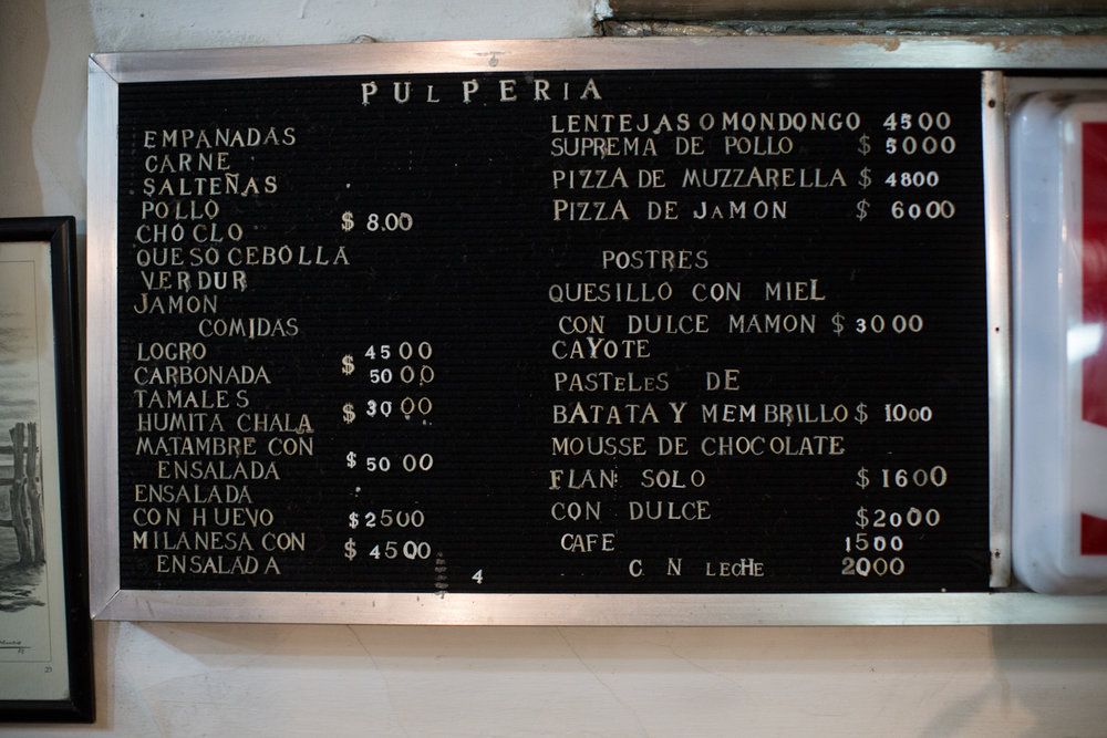 The food side of the menu. At black market rates, US $1 got us AR $8.5 (in 2014). Empanadaas listed top left.