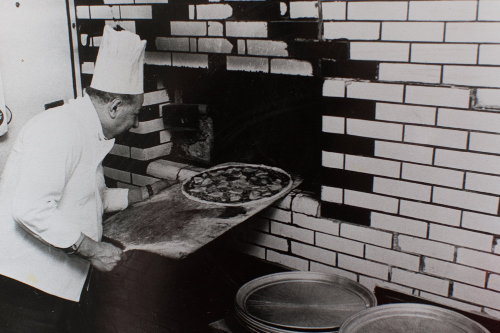 Gennaro Lombardi at the original Lombardi's coal-burning oven, c. 1956 (Photo courtesy Gerry Lombardi)