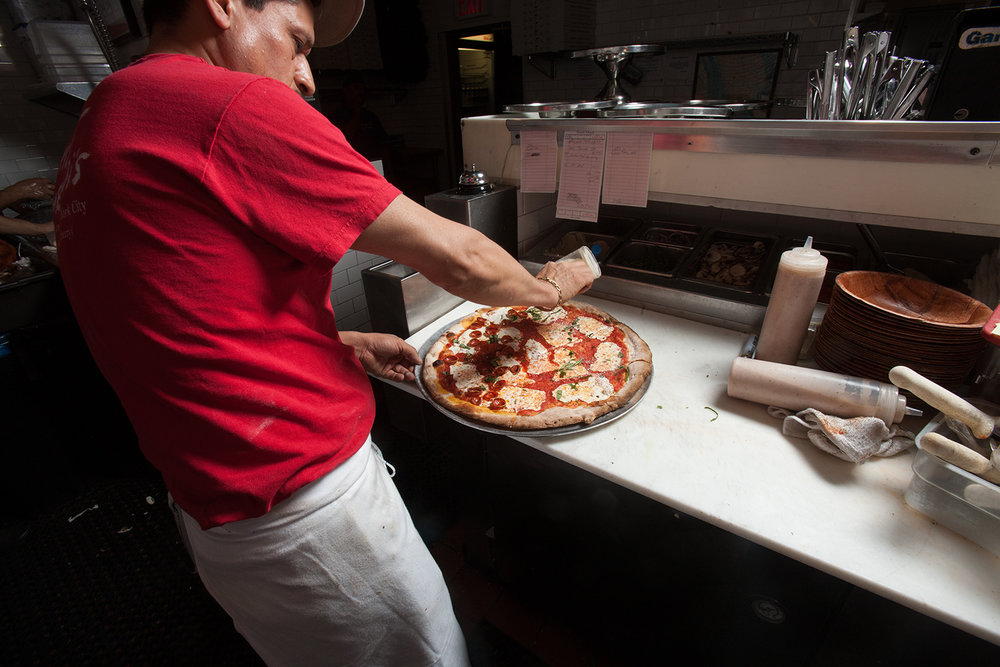 ...but the flavor imparted by a coal-burning oven offers a culinary glimpse into America's pizza past.