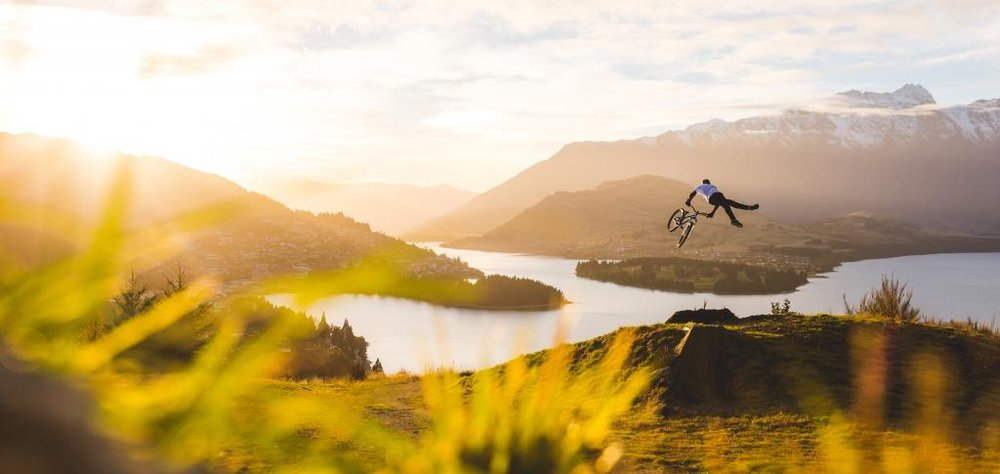 Mountain-biker-jumping-above-Queenstown-NZ.jpg
