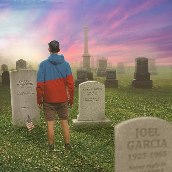 man_standing_in_cemetery.jpg