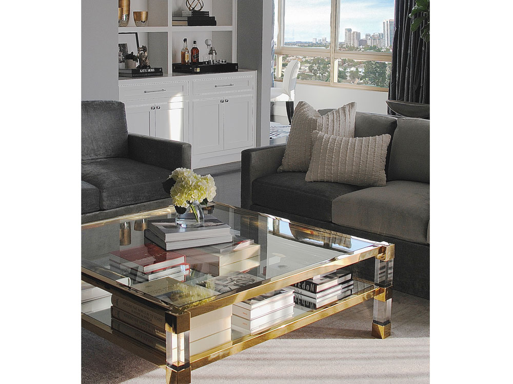 A lucite coffee table in a Saghian-designed living room.