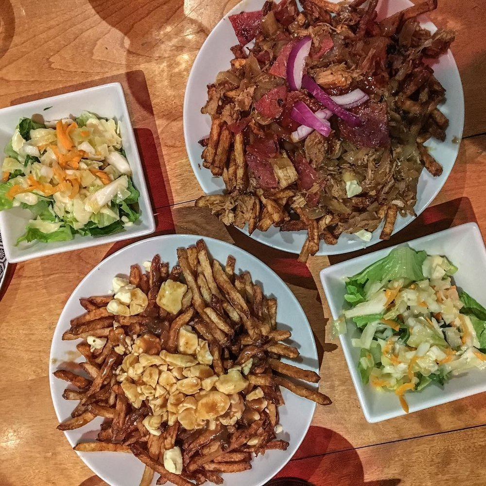 Getting acquainted with Poutine, a Canadian dish from Québec, fries with cheese curds and brown gravy. Yum!   - @gelo.bean
