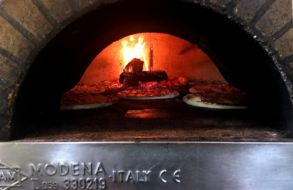 Everything that we cook is always cooked on all wood fire.
