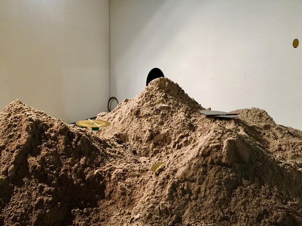 Sand, glitter, acrylic, mohair, brass, soundscape (2017)