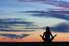 yoga-silhouette-woman-practicing-outdoors-30451078.jpg