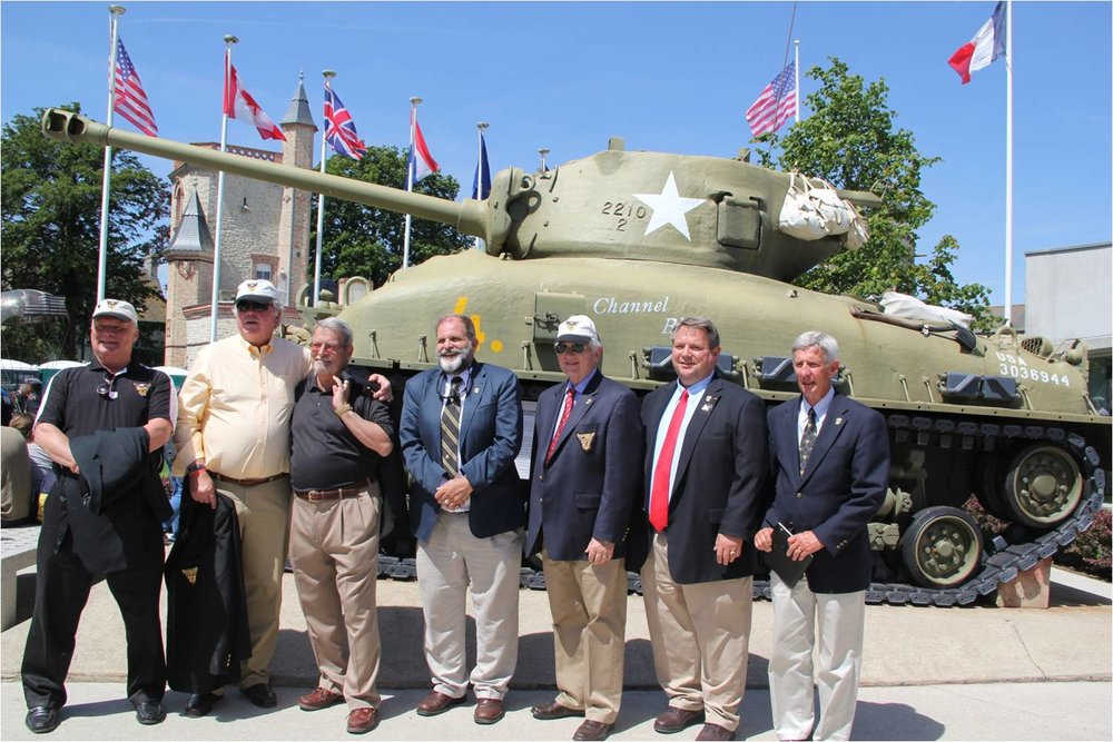 6 West Point veterans from left to right Jim, Tom, Alan, Hank, Bill & Mark and West Point Track Coach Joe 6 June 2014 at Ste, Mere Eglise on our D Day Tour