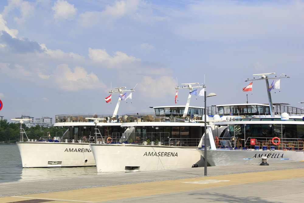 3 AmaWaterways riverships rafted (tied together) in Vienna—you would never see this picture in a travel brochure, since some cabins views are blocked—may be or not a big deal to you during a vacation, but you can trust us to tell you about this!