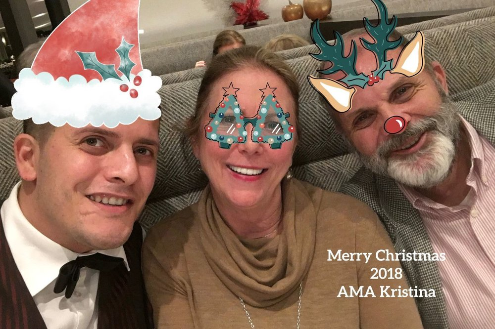 Our Waiter Catilan with the Schrader's—a Christmas Greeting Created by Anne!—Are we festive enough?