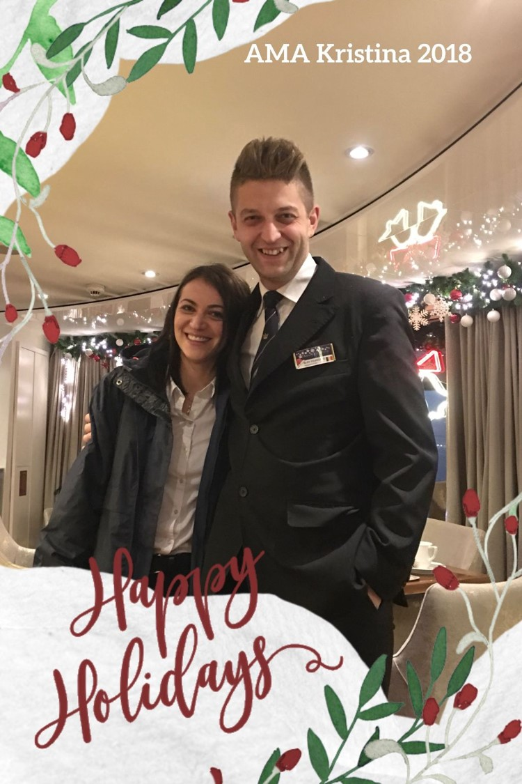 Alex (assistant head waiter) and his Girlfriend crew member Alexandra (reception) with a Christmas Greeting created by Anne