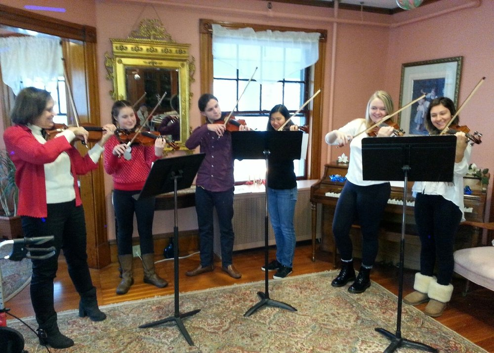 One of Susan's string ensemble performing for Girdler House retirement home residents in Beverly