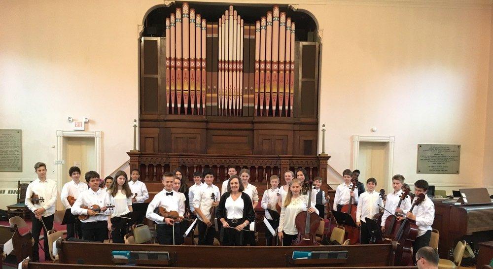 "Susan conducting her middle-school orchestra students performing the Albinoni ""Adagio"" and Vivaldi ""Gloria."""