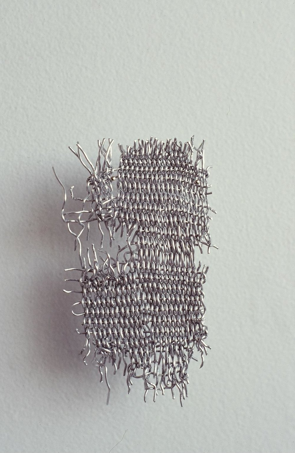 """Untitled, 1.5"""" x 2.5"""", finger-woven wire, 1998"""