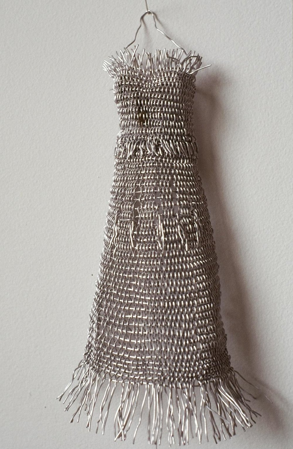 """Gown, 4"""" x 6"""", finger-woven wire, 1998"""