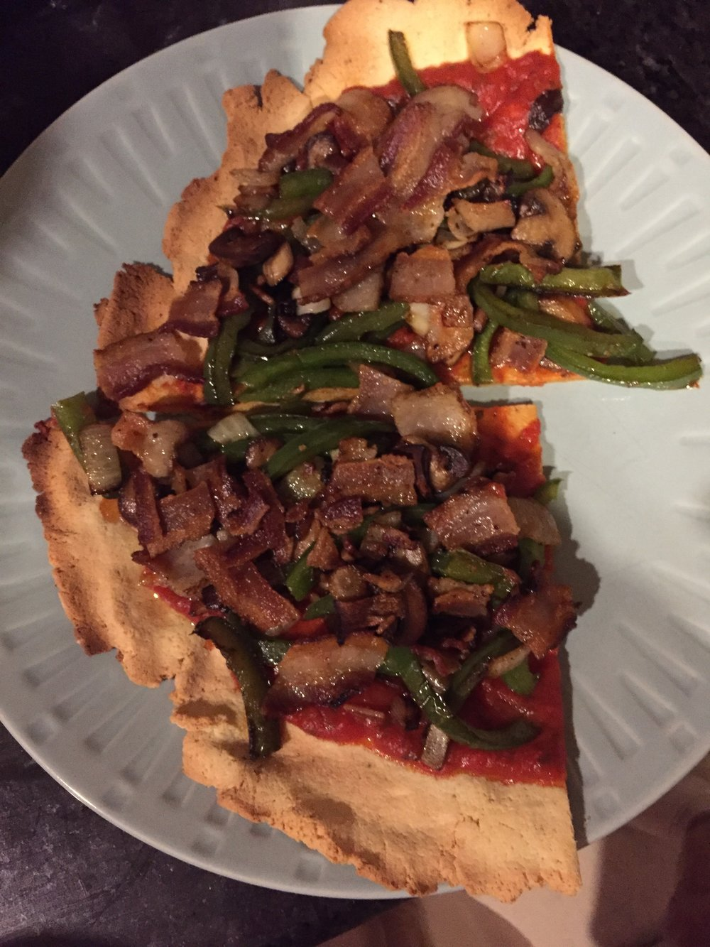 Almond flour pizza with W30 compliant bacon, onions, green peppers, and mushrooms.
